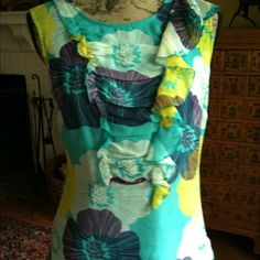 Beautiful floral silk top Lined silk georgette top with side zip and bottom closure at neck Tops