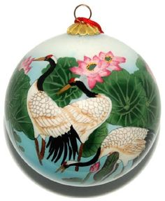 $17.99-$25.99 For the Japanese, the crane - or tsuru - is considered a national treasure, appearing in art, literature, and folklore. The crane is regarded as a symbol of good fortune and longevity because of its fabled life span of a thousand years. Each hand-blown glass ornament is hand painted in reverse on the inside of the glass. Choosing from a selection of miniature curved shaft brushes,  ...