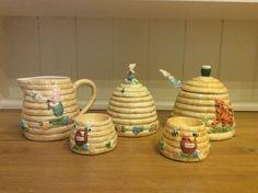 Winnie the Pooh sugar bowl milk jug honeypot and two egg cups.