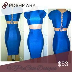 Ms. BLUE ?????? This custom made sexy two piece is great for a night out with the girls, or date night. It features a high waist pencil skirt with a blue corset back crop top . Dresses