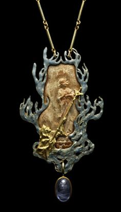 René Lalique Joan of Arc pendant. Enamelled gold rectangular pendant enclosing a gold relief representing Joan of Arc burnt at the stake, with a man below holding up a crucifix, framed by flames to every side, sapphire hanging below, c1900 Rene Lalique (1860-1945).