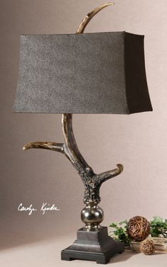 Stag Horn, Dark Shade, Table Lamp. This lamp has a burnished bone ivory finish with a crackled wood tone base and cast aluminum accents. The rectangle semi drum shade is a sueded chocolate textile.