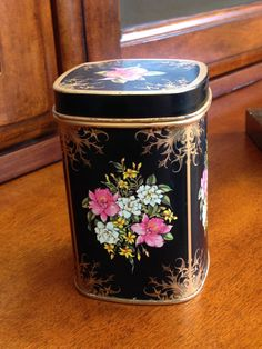 Vintage Collectible Tin. floral on black, one of my very favorites!