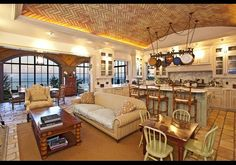 """La Villa Contenta, Malibu, CA  Originally listed for 75 million for the entire compound, developer Richard Weintraub's personal residence has appeared in films and TV shows and is available for purchase as several lots or for rent. The property includes13 bedrooms, 14 baths, a guest house, tennis courts, an outdoor pool, an opulent """"natatorium"""" with murano glass tiled indoor lap pool and onyx fireplace, a greenhouse, and an organic """"kitchen garden."""""""
