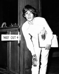 Being belt-less is way out. Simply ask the older & wiser Mr Jagger.