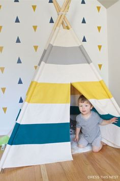 I made a teepee for my sons' room inspired by Land of Nod. Find out how here with detailed instructions and a pattern to make it yourself!: