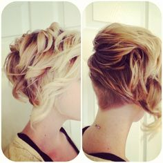 Short hair with lots of body, curls and texture with an undercut in the back