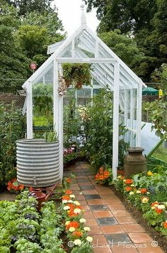 with Flagstones Greenhouse in the backyard.I want the rain barrel with spigot!Greenhouse in the backyard.I want the rain barrel with spigot! Greenhouse Shed, Greenhouse Gardening, Outdoor Greenhouse, Small Greenhouse, Greenhouse Wedding, Greenhouse Growing, Gardening Books, Outdoor Planters, Dream Garden
