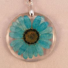 Hey, I found this really awesome Etsy listing at https://www.etsy.com/uk/listing/487620577/resin-dried-flower-pendants-blue