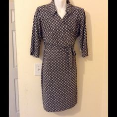 Black and a White Wrap Dress Gently worn wrap dress, nice when couple with boots or a blazer Dresses