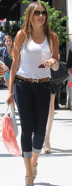 Who made  Sofía Vergara's nude platform sandals, white handbag, brown belt, and sunglasses that she wore in New York?