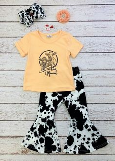 """A pair of cows """"Not In the Mooood"""" stamp printed on the front of this soft peach rolled cuff t-shirt, and cow print bell bottom pants to complete the set. Any accessories shown are not included. #cowprint #mood #bellbottom #cow #boutiquefashion Cute Country Outfits, Cute Baby Girl Outfits, Cute Outfits For Kids, Cute Baby Clothes, Toddler Outfits, Cowgirl Baby, Cowgirl Nursery, Western Baby Clothes, 1st Birthday Outfits"""
