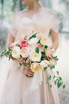 A gorgeous bouquet of roses compliments this bride's romantic tulle ball gown, fabulous for a vintage-inspired wedding!