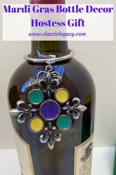 Dress up a wine bottle gift with this wine bottle décor!    It is a silver ring that fits around the neck of a wine bottle.   This is embellished with a large medallion that features four fleur de lis and the enameled center with the colors of Mardi Gras. Wine Bottle Gift, Wine Bottle Stoppers, Mardi Gras, Custom Wine Bottles, Wine Carrier, Wine Charms, Hostess Gifts, Decoration, Customized Gifts