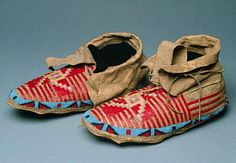 Circa 1890   Lakota moccasins with red quilled central cross stripes on vamps.