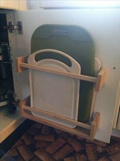 What a GREAT idea!!!! Cutting board storage from hacked $4 ikea spice racks. One of my better ideas :-)