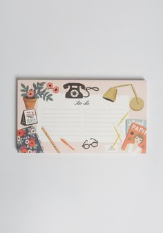 Stay organized with this adorable notepad adorned with illustrated floral, desktop, and Parisian-inspired graphics!