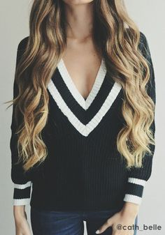 This black v neckline sweaters is a versatile clothing piece you can throw on with any bottom wear.