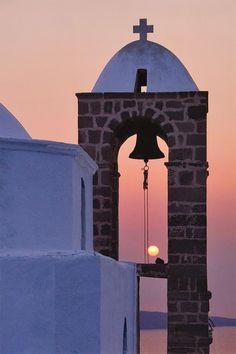 Church steeple at sunset in Santorini, Greece