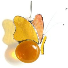 Amber Butterfly Mobile, Stained Glass Butterfly Suncatcher Home Decor,... ($22) ❤ liked on Polyvore featuring home, home decor, windows stained glass, butterfly home decor, butterfly stained glass and mobile home decor