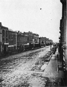Christmas Day 1877, looking down the 400 block of Main Street.