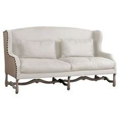 "Add a charming touch to your living room or den with this chic sofa, showcasing a wood frame and nailhead accents.  Product: SofaConstruction Material: Hardwood solids, linen, metal and juteColor: Off-white and antique ironFeatures:  Antiqued iron nailhead trimAccent pillows includedH-shaped base Dimensions: 42"" H x 76"" W x 33"" D"