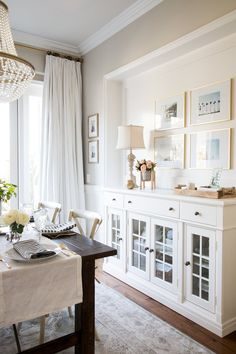 Get inspired by Traditional Dining Room Design photo by Joss & Main. Wayfair lets you find the designer products in the photo and get ideas from thousands of other Traditional Dining Room Design photos. Sideboard Dekor, Dining Room Sideboard, Dining Room Wall Decor, Dining Room Lighting, Dining Room Design, Dining Room With Buffet, White Buffet Table, Dining Room Storage, Fireplace In Dining Room