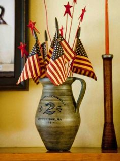 Skip the cut flowers—for a simple arrangement that stays fresh all summer long, set a handful of miniature flags and star picks inside a stoneware jug. Prim Decor, Primitive Decorations, Patriotic Images, I Love America, Red Cottage, 4th Of July Decorations, Holidays And Events, Happy Holidays, Old Glory