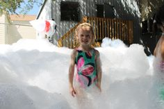 You can do this in your backyard. Foam party fun makes for great photos.