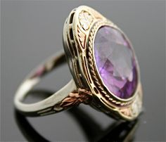 Gold Antique Ring...I don't usually like gold but this is striking for some reason. Maybe it's the purple gem. It is my favorite color after all:)