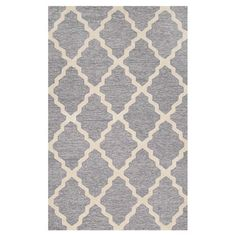 Anchor your living room seating group or define space in the den with this handcrafted wool rug, showcasing a chic trellis motif in gray.   ...
