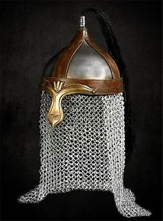 Replica Mongolian helmet, based on the helmets mounted nomadic archers wore on the Eurasian steppes in ancient and medieval times. The bowl of the helmet is made of coated steel and the nose guard of antiqued brass. This Mongolian helmet has a protective aventail at the back, and the decorative crest is made of genuine horsehair.