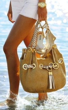 Michael Kors .Don't we always walk on the beach with our purse. LOL Picture cracks me up. Still like the purse.