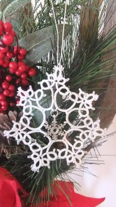 Hand tatted Christmas ornament  snowflake with charm by IzabelkaG