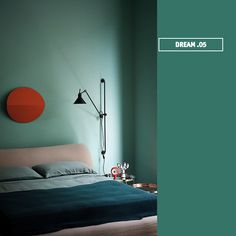 A minty shade of blue, Colorhouse Dream.05, completes this bedroom's serene color palette.