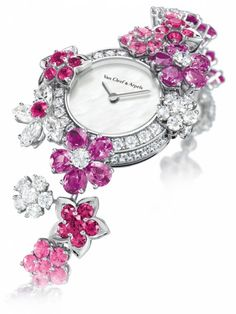 OMG The watches on this website are incredible! I'll take two, please-the pink stones one, and the blue stones one ;-)
