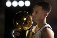 Golden State Warriors' Stephen Curry poses with the Larry O'Brien trophy during the team's annual media day, Monday, Sept. 28, 2015, in Oakland, Calif. (D. Ross Cameron/Bay Area News Group)
