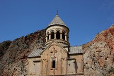 Noravank is a 13th-century Armenian monastery, located 122km from Yerevan in a narrow gorge made by the Amaghu River, near the city of Yeghegnadzor, Armenia. The gorge is known for its tall, sheer, brick-red cliffs, directly across from the monastery.