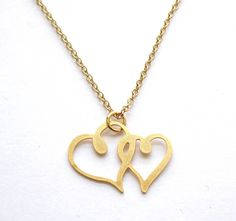 """Connected Heart Pendant Necklace   This Beautiful love necklace features a 1.18"""" (3 cm) heart pendant made of gold acrylic. It comes on a gold plated cable chain.  The chain is approx.17.71"""" (45 cm) long.  A chic look for any occasion.  All of my jewelry comes with a gift box.   $32.9"""