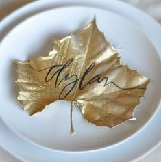 Gold-painted leaf place card for Thanksgiving