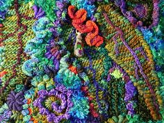 close-up of freeform knit & crochet fabric by  Prudence Mapstone using many of the techniques in her books - www.knotjustknitting.com