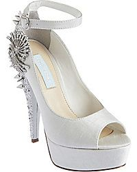 Studded, white heels with blue soles by Betsey Johnson.  Did you see these Marie?