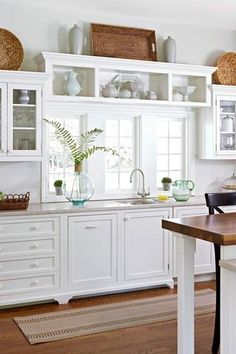 Traditional Kitchen with Flat panel cabinets, Cork flooring, Kitchen island, Subway Tile, Flush, Limestone counters, One-wall