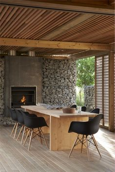 Like the combination of gambion walls, shutters and timber ceiling