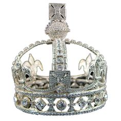 Queen Victoria's small diamond crown.  It contains 1,187 diamonds and is made of silver.  The queen had this crown made because she wanted something less heavy to wear than her other tiaras and crowns and also something that would be appropriate to wear with her mourning dress (colored stones are not to be worn when in mourning).  (Captions by Ashley Hedges)