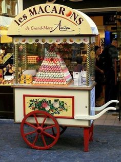 i love the style of this cart but maybe not selling macarons- perhaps just french market type goodies?