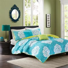 Update your space with style and comfort. The Intelligent Design Tanya Coverlet Set combines a modern teal with a cool green reverse to highlight this beautiful white damask print. Two decorative pillows feature fabric manipulation and a geometric embroidery design to add dimension to the top of bed.
