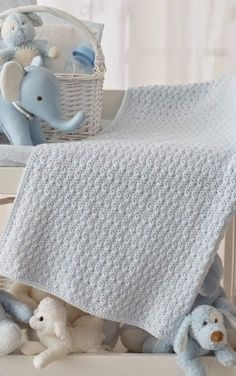 Easy Crochet Afghans Textured Crochet Baby Blanket - Gorgeous Free Pattern from our friends at CraftFoxes - Worked in a shell pattern, this textured crochet blanket has a cabled look--a perfectl.