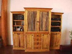 Southwest Entertainment Center Has Saguaro Rib Cactus in the Main Doors. Rustic Pine Boards are used through out. Mexican Hardware Pulls are on all the SW Entertainment Door Fronts