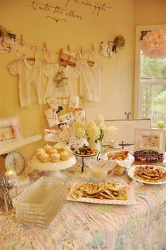 Vintage Baby Shower - a very nice menu of fruit salsa and cinnamon chips, hummas and pita chips, Sundried Tomato Pesto Palmiers, a berry cake, lime cupcakes.